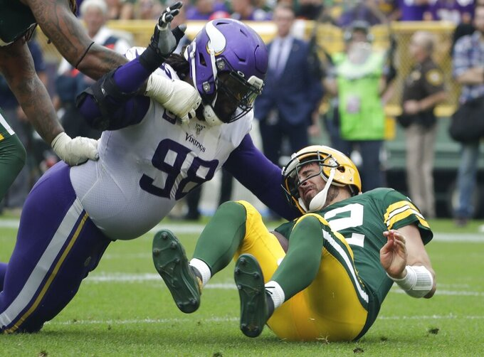 Minnesota Vikings' Linval Joseph sacks Green Bay Packers' Aaron Rodgers during the second half of an NFL football game Sunday, Sept. 15, 2019, in Green Bay, Wis. (AP Photo/Morry Gash)