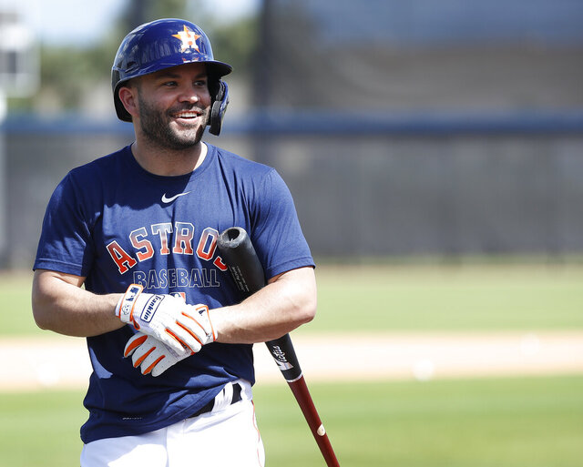 Houston Astros second baseman Jose Altuve (27) smiles before taking batting practice during spring training baseball practice, Tuesday, Feb. 18, 2020 in West Palm Beach, Fla. (Karen Warren/Houston Chronicle via AP)