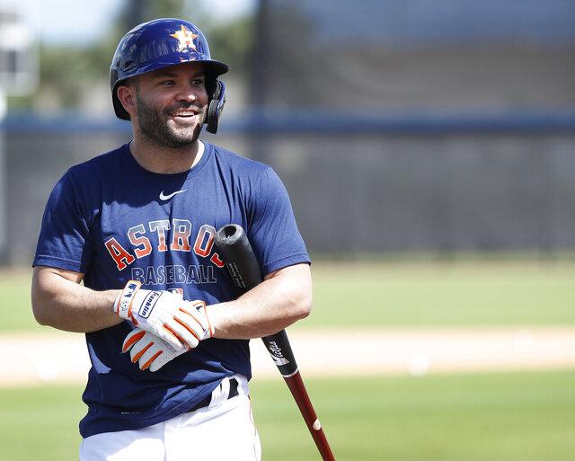 Houston Astros second baseman Jose Altuve (27) smiles before taking batting practice during spring training baseball practice, Tuesday, Feb. 18, 2020 in West Palm Beach, Fla. (Karen Warren/Houston Chronicle via AP)