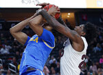 Arizona State's Romello White, right, fouls UCLA's Moses Brown during the first half of an NCAA college basketball game in the quarterfinals of the Pac-12 men's tournament Thursday, March 14, 2019, in Las Vegas. (AP Photo/John Locher)
