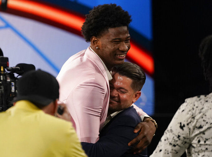 Kai Jones reacts after being selected as the 19th overall selection by the New York Knicks during the NBA basketball draft, Thursday, July 29, 2021, in New York. (AP Photo/Corey Sipkin)