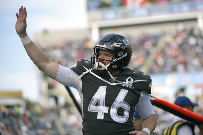 FILE - AFC long snapper Morgan Cox (46), of the Baltimore Ravens, waves to fans in the stands after the first half of the NFL Pro Bowl football game against the NFC in Orlando, Fla., in this Sunday, Jan. 26, 2020, file photo. Ravens general manager Eric DeCosta has already started making some of the tough decisions he believes can help Baltimore negotiate the leap from playoff qualifier to Super Bowl champion. After releasing running back Mark Ingram and quarterback Robert Griffin III last week, DeCosta announced Monday, Jan. 25, 2020, that the Ravens won't re-sign All-Pro long snapper Morgan Cox, the initial component of the highly successful placekicking trio that includes holder Sam Koch and second-team All-Pro Justin Tucker, the most accurate field goal kicker in NFL history.(AP Photo/Phelan M. Ebenhack)