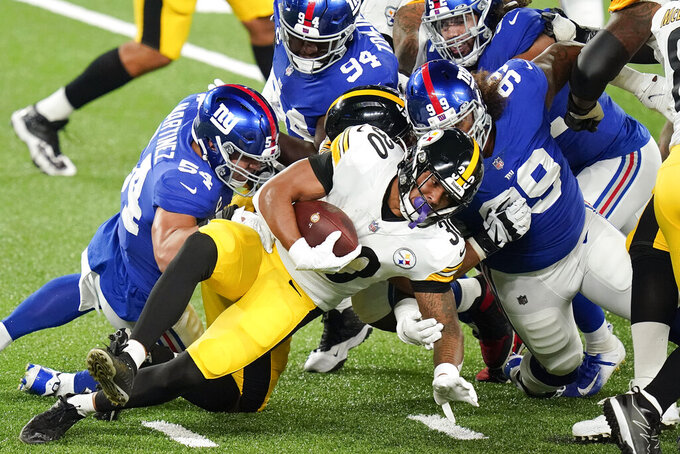 Pittsburgh Steelers running back James Conner (30) is tackled by the New York Giants during the first quarter of an NFL football game Monday, Sept. 14, 2020, in East Rutherford, N.J. (AP Photo/Frank Franklin II)