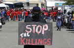 A white protester against farm murders stands near the magistrates court in Senekal, South Africa, Friday, Oct. 16, 2020 where two suspects were to appear on charges of killing a white farmer in the area. The killing of a white farmer allegedly by two black men in South Africa has stoked racial tensions and threatened to ignite violence between racial groups in the Free State province. It has also highlighted concerns about the government's inability to deal with crime in general and killings in the country's rural and farming communities. (AP Photo/Themba Hadebe)