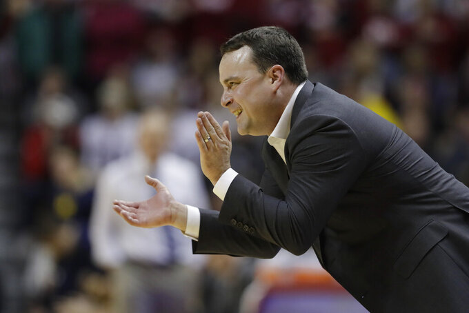 Indiana coach Archie Miller encourages his team during the first half of an NCAA college basketball game against Michigan, Friday, Jan. 25, 2019, Bloomington, Ind. (AP Photo/Darron Cummings)