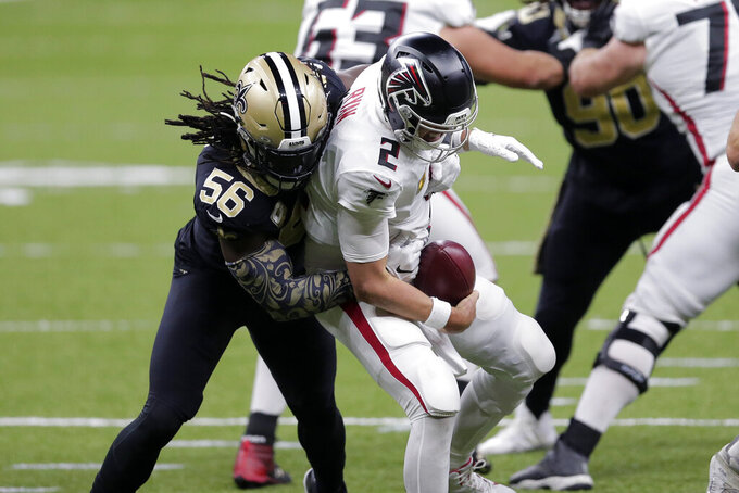 Atlanta Falcons quarterback Matt Ryan (2) is sacked by New Orleans Saints outside linebacker Demario Davis (56) in the second half of an NFL football game in New Orleans, Sunday, Nov. 22, 2020. (AP Photo/Brett Duke)