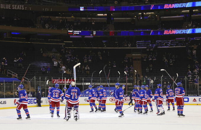 The New York Rangers celebrate a victory over the Buffalo Sabres in an NHL hockey game Monday, March 22, 2021, in New York. (Bruce Bennett/Pool Photo via AP)