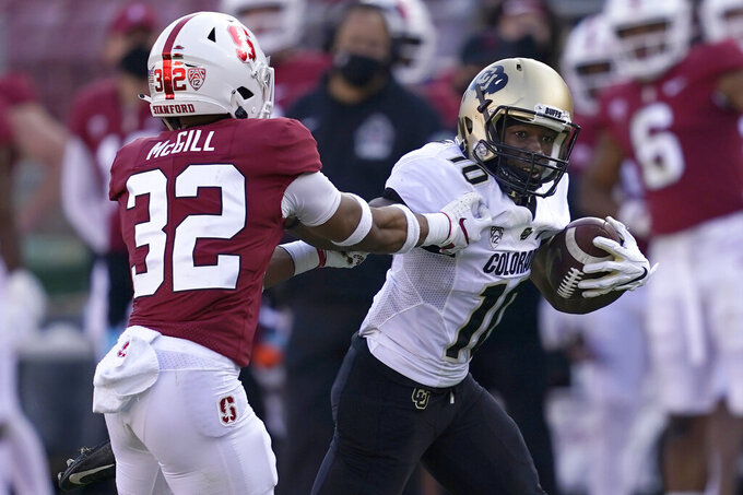 Colorado wide receiver Jaylon Jackson (10) runs against Stanford safety Jonathan McGill (32) during the second half of an NCAA college football game in Stanford, Calif., Saturday, Nov. 14, 2020. (AP Photo/Jeff Chiu)