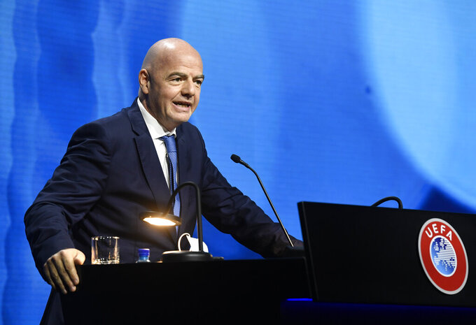 """FIFA President Gianni Infantino speaks during the 45th UEFA Congress in Montreux, Switzerland, Tuesday April 20, 2021. In a speech that seemed to blame the club owners and absolve players, FIFA president Gianni Infantino said he can only """"strongly disapprove"""" of the Super League. """"If some elect to go their own way, then they must live with the consequences of their choice,"""" Infantino said. """"They are responsible for their choice."""" (Richard Juilliart/UEFA via AP)"""