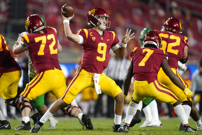 FILE - In this Dec 18, 2020, file photo, Southern California quarterback Kedon Slovis (9) throws a pass during the second quarter of an NCAA college football Pac-12 Conference championship game in Los Angeles. About 16 starters return from last season's Pac-12 South champions, led by third-year starting quarterback Kedon Slovis with USC's usual wealth of skill-position talent around him. (AP Photo/Ashley Landis, File)