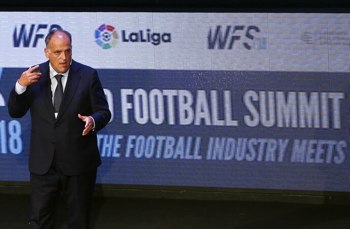 FILE - In this Monday, Sept. 24, 2018 file photo, Javier Tebas, the president of the Spanish La Liga, speaks during the World Football summit in Madrid, Spain. The Spanish soccer league says the country's data protection agency doesn't understand the technology being used on its official app. The league was fined 250,000 euros ($283,000) for using a microphone in its app, but says it will challenge the decision. (AP Photo/Paul White, File)