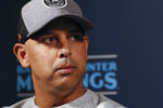 FILE - In this Dec. 9, 2019, file photo, Boston Red Sox manager Alex Cora listens to a question during the Major League Baseball winter meetings, in San Diego. Houston  manager AJ Hinch and general manager Jeff Luhnow were suspended for the entire season Monday, Jan. 13, 2020,  and the team was fined $5 million for sign-stealing by the team in 2017 and 2018 season. Commissioner Rob Manfred announced the discipline and strongly hinted that current Boston manager Alex Cora — the Astros bench coach in 2017 — will face punishment later. Manfred said Cora developed the sign-stealing system used by the Astros. (AP Photo/Gregory Bull, File)