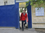 Russian opposition activist Alexei Navalny leaves a detention center in Moscow, Russia, Thursday, June 14, 2018. Navalny has been sentenced to 30 days in jail over an unauthorized protest. (AP Photo/Dmitry Serebryakov)