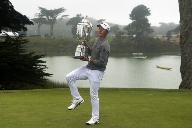 Collin Morikawa holds the Wanamaker Trophy after winning the PGA Championship golf tournament at TPC Harding Park Sunday, Aug. 9, 2020, in San Francisco. (AP Photo/Jeff Chiu)