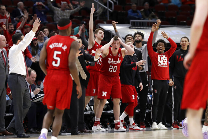 Nebraska bench react to a 3-point shot by Glynn Watson Jr. (5) during the second half of an NCAA college basketball game against the Maryland in the second round of the Big Ten Conference tournament, Thursday, March 14, 2019, in Chicago. The Nebraska won 69-61. (AP Photo/Nam Y. Huh)