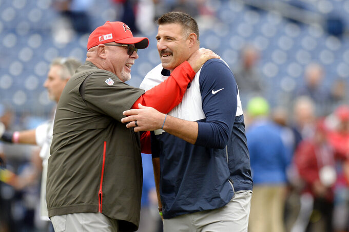 Tampa Bay Buccaneers head coach Bruce Arians, left, greets Tennessee Titans head coach Mike Vrabel before an NFL football game Sunday, Oct. 27, 2019, in Nashville, Tenn. (AP Photo/Mark Zaleski)