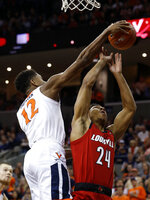 Virginia guard De'Andre Hunter (12) blocks the shot of Louisville forward Dwayne Sutton (24) during the first half of an NCAA college basketball game in Charlottesville, Va., Saturday, March 9, 2019. (AP Photo/Steve Helber)