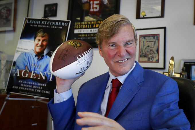 FILE - In this Feb. 13, 2020, file photo, agent Leigh Steinberg poses for a picture at his office in Newport Beach, Calif. Steinberg and his agency represent 12 NFL draft-eligible players, including a pair of first-round prospects: Alabama's Tua Tagovailoa and Jerry Jeudy. (AP Photo/Chris Carlson, File)