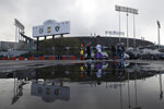 In this Dec. 8, 2019, photo, fans tailgate at RingCentral Coliseum before an NFL football game between the Oakland Raiders and the Tennessee Titans in Oakland, Calif. The Raiders' final scheduled game in Oakland on Sunday, Dec. 15, 2019, will be an emotional one for players and coaches, as well as fans. (AP Photo/Jeff Chiu)