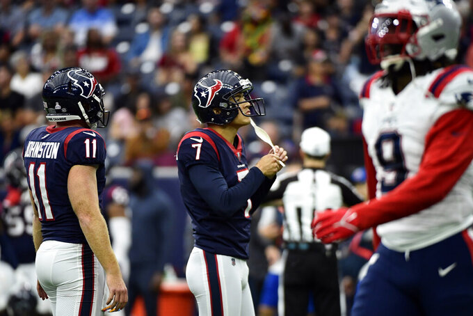 Houston Texans place kicker Ka'imi Fairbairn (7) reacts after missing an extra point against the New England Patriots during the first half of an NFL football game Sunday, Oct. 10, 2021, in Houston. (AP Photo/Justin Rex)