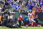 New York Giants' Golden Tate (15) runs away from New York Jets' Brian Poole (34) for a touchdown during the second half of an NFL football game Sunday, Nov. 10, 2019, in East Rutherford, N.J. (AP Photo/Steven Ryan)