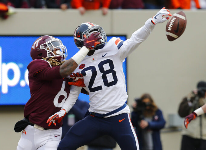 Virginia safety Brenton Nelson (28) breaks up pass intended for Virginia Tech wide receiver Hezekiah Grimsley (6) during the first half of an NCAA college football game in Blacksburg, Va., Friday, Nov. 23, 2018. (AP Photo/Steve Helber)