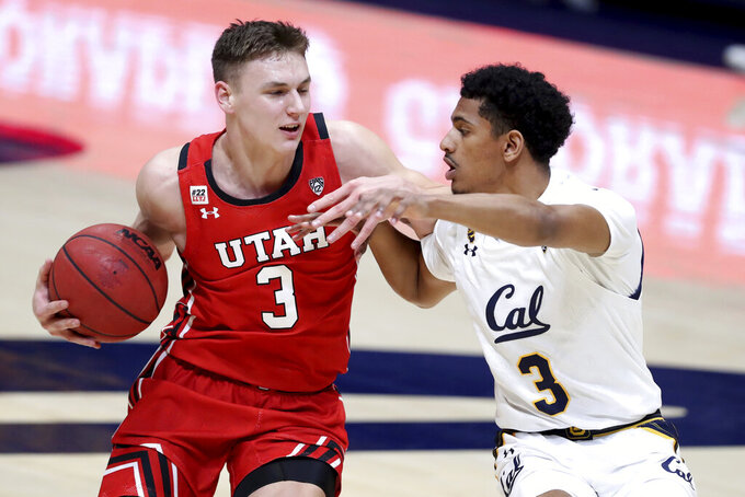 Utah forward Pelle Larsson, left, drives to the basket against California guard Jarred Hyder during the first half of an NCAA college basketball game in Berkeley, Calif., Thursday, Feb. 11, 2021. (AP Photo/Jed Jacobsohn)