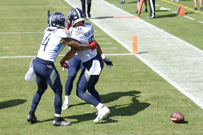 Tennessee Titans wide receiver Adam Humphries (10) celebrates with wide receiver Kalif Raymond (14) after Humphries scored a touchdown against the Jacksonville Jaguars in the second half of an NFL football game Sunday, Sept. 20, 2020, in Nashville, Tenn. (AP Photo/Mark Zaleski)