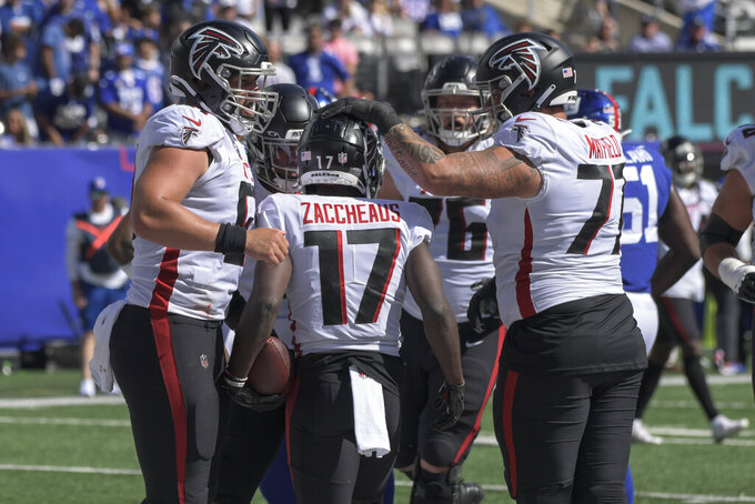 Atlanta Falcons wide receiver Olamide Zaccheaus (17) celebrates with his teammates after scoring a touchdown during the first half of an NFL football game against the New York Giants, Sunday, Sept. 26, 2021, in East Rutherford, N.J. (AP Photo/Bill Kostroun)
