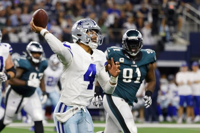 Dallas Cowboys quarterback Dak Prescott (4) is pressured by Philadelphia Eagles defensive tackle Fletcher Cox (91) before throwing a pass in the first half of an NFL football game in Arlington, Texas, Monday, Sept. 27, 2021. (AP Photo/Michael Ainsworth)