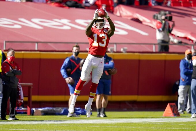 Kansas City Chiefs wide receiver Byron Pringle (13) catches a pass on a fake punt play for a first down in the first half of an NFL football game against the New York Jets on Sunday, Nov. 1, 2020, in Kansas City, Mo. (AP Photo/Jeff Roberson)