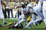 Indianapolis Colts running back Marlon Mack (25) is tackled by Pittsburgh Steelers linebacker Devin Bush (55) during the second half of an NFL football game in Pittsburgh, Sunday, Nov. 3, 2019. The Steelers won 26-24. (AP Photo/Don Wright)