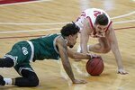 Wisconsin's Trevor Anderson and Wisconsin-Green Bay's Josh Jefferson go after a loose ball during the second half of an NCAA college basketball game Tuesday, Dec. 1, 2020, in Madison, Wis. (AP Photo/Morry Gash)