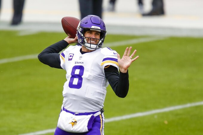 Minnesota Vikings' Kirk Cousins throws before an NFL football game against the Green Bay Packers Sunday, Nov. 1, 2020, in Green Bay, Wis. (AP Photo/Matt Ludtke)