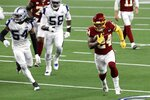 Washington Football Team running back Antonio Gibson sprints to the end zone for a touchdown after getting past Dallas Cowboys linebacker Jaylon Smith (54) and Aldon Smith (58) in the second half of an NFL football game in Arlington, Texas, Thursday, Nov. 26, 2020. (AP Photo/Roger Steinman)