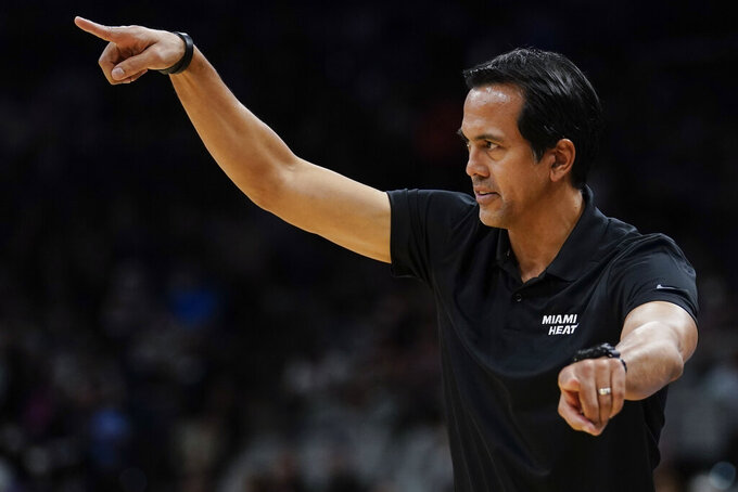 Miami Heat head coach Erik Spoelstra signals to his players during the first half of a preseason NBA basketball game against the San Antonio Spurs, Friday, Oct. 8, 2021, in San Antonio. (AP Photo/Darren Abate)