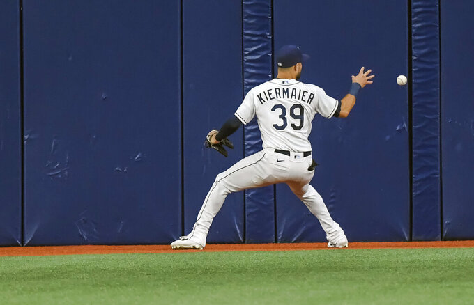 Tampa Bay Rays center fielder Kevin Kiermaier reaches for a line-drive single off the wall hit by New York Yankees' Gleyber Torres during the fourth inning of a baseball game Tuesday, July 27, 2021, in St. Petersburg, Fla. (AP Photo/Steve Nesius)