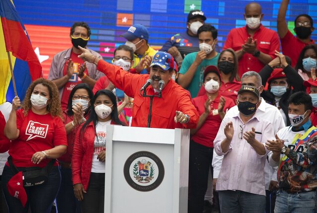 Venezuela's President Nicolas Maduro speaks to supporters during a closing campaign rally for the upcoming National Assembly elections in Caracas, Venezuela, Thursday, Dec. 3, 2020. Venezuelans will vote for a new National Assembly this Sunday, Dec 6. (AP Photo/Ariana Cubillos)