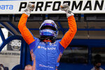 Scott Dixon, of New Zealand, celebrates after winning the pole during qualifications for the Indianapolis 500 auto race at Indianapolis Motor Speedway in Indianapolis, Sunday, May 23, 2021. (AP Photo/Michael Conroy)