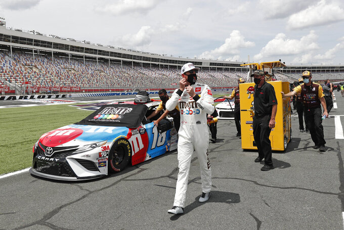 Driver Kyle Busch walks along pit road during qualifying for a NASCAR Cup Series auto race at Charlotte Motor Speedway Sunday, May 24, 2020, in Concord, N.C. (AP Photo/Gerry Broome)