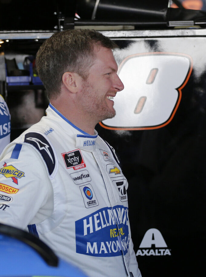 Dale Earnhardt Jr. smiles in the garage before practice for a NASCAR auto race, Friday, Aug. 30, 2019, in Darlington, S.C.. Earnhardt is scheduled to run in the Xfinity race on Saturday. (AP Photo/Terry Renna)