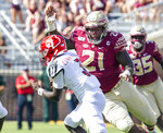 FILE - In this Sept. 21, 2019, file photo, Florida State defensive tackle Marvin Wilson (21) moves in for the sack of Louisville quarterback Malik Cunningham (3) in the first half of an NCAA college football game in Tallahassee, Fla. Wilson was selected to The Associated Press preseason All-America first-team, Tuesday, Aug. 25, 2020. (AP Photo/Mark Wallheiser)