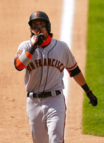 San Francisco Giants' Mauricio Dubon reacts at he reaches home plate after hitting a three-run home run in the seventh inning of a baseball game against the Colorado Rockies, Thursday, Aug. 6, 2020, in Denver. (AP Photo/Jack Dempsey)