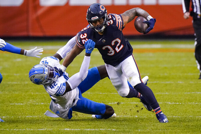 Detroit Lions safety Jayron Kearse (42) tackles Chicago Bears running back David Montgomery (32) in the second half of an NFL football game in Chicago, Sunday, Dec. 6, 2020. (AP Photo/Nam Y. Huh)