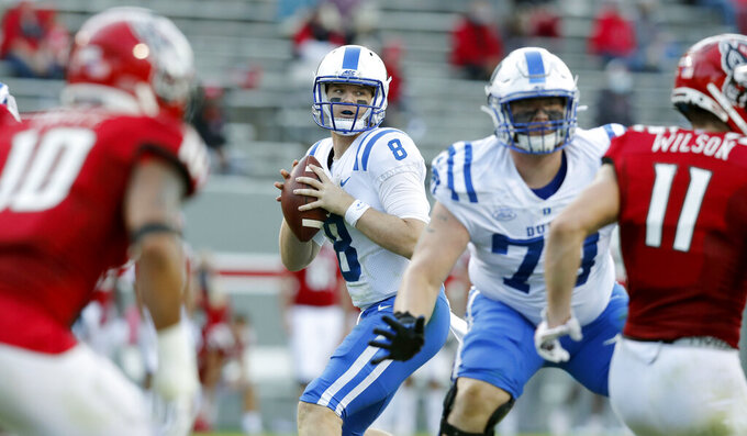 Duke quarterback Chase Brice (8) looks for a receiver during the first half of an NCAA college football game against North Carolina State at Carter-Finley Stadium in Raleigh, N.C., Saturday, Oct. 17, 2020. (Ethan Hyman/The News & Observer via AP)