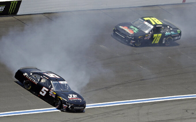 Matt Mills (5) spins in front of Vinnie Miller (78) during the NASCAR Xfinity Series auto race at Charlotte Motor Speedway in Concord, N.C., Saturday, May 25, 2019. (AP Photo/Chuck Burton)