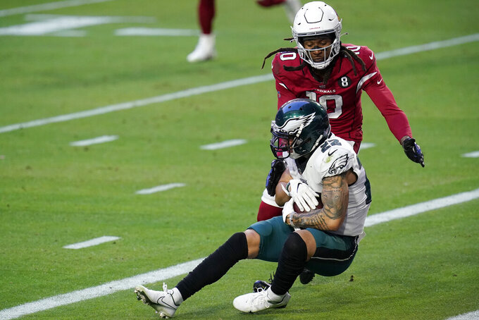 Philadelphia Eagles safety Marcus Epps (22) intercepts a pass as Arizona Cardinals wide receiver DeAndre Hopkins (10) defends during the second half of an NFL football game, Sunday, Dec. 20, 2020, in Glendale, Ariz. (AP Photo/Ross D. Franklin)