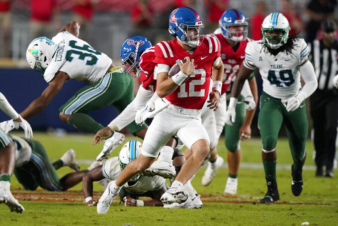 Mississippi quarterback Kinkead Dent (12) runs with the ball as Tulane linebacker Armoni Dixon (49) pursues during the second half of an NCAA college football game Saturday, Sept. 18, 2021, in Oxford, Miss. Mississippi won 61-21. (AP Photo/Rogelio V. Solis)