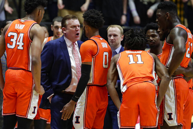 Illinois head coach Brad Underwood speaks with guard Alan Griffin (0) after being called for a foul during the first half of an NCAA college basketball game against Purdue in West Lafayette, Ind., Tuesday, Jan. 21, 2020. Griffin was ejected for the foul. (AP Photo/Michael Conroy)
