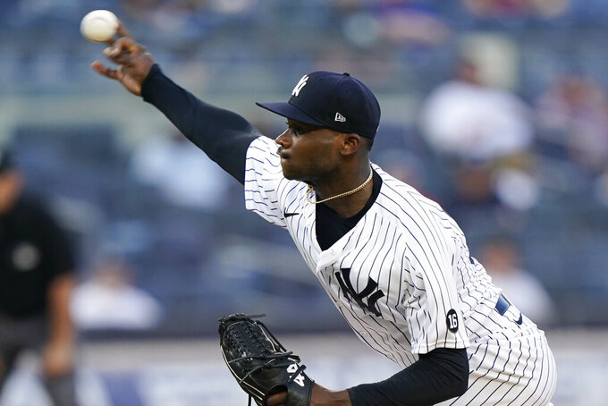 New York Yankees starting pitcher Domingo German  delivers during the first inning of a baseball game against the Boston Red Sox, Sunday, June 6, 2021, at Yankee Stadium in New York. (AP Photo/Kathy Willens)